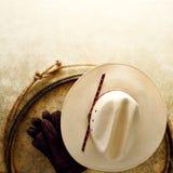 Sombrero de vaquero del rodeo y cuerda del oeste americanos del lazo Foto de archivo libre de regalías