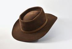 Sombrero de vaquero marrón del vintage en el fondo blanco Imagen de archivo