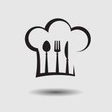 Sombrero del cocinero con la cuchara, el cuchillo y la bifurcación Foto de archivo