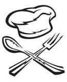 sombrero del cocinero con la cuchara y la fork Foto de archivo libre de regalías
