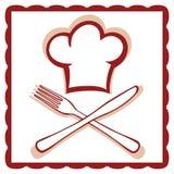 Sombrero del cocinero con la muestra del cuchillo y de la fork Foto de archivo