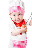 Sombrero del cocinero de la muchacha del cocinero del bebé que lleva con las verduras frescas y las frutas. Imagen de archivo