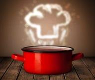 Sombrero del cocinero sobre cocinar el pote Imágenes de archivo libres de regalías
