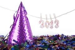 Sombrero del partido con 2012 velas Foto de archivo libre de regalías