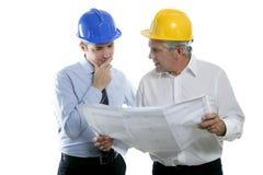 Sombrero duro del plan de las personas de la maestría del arquitecto dos del ingeniero Fotos de archivo libres de regalías
