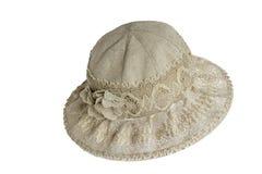 Sombrero femenino del verano para la protección contra el sol en una parte posterior del blanco imagenes de archivo