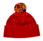 Sombrero hecho punto aislado en el fondo blanco sombrero con el pompón imagen de archivo