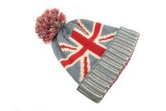 Sombrero hecho punto de las lanas con la unión Jack Flag Isolated On White Foto de archivo libre de regalías