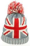 Sombrero hecho punto de las lanas con la unión Jack Flag Isolated On White Fotografía de archivo libre de regalías