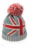Sombrero hecho punto de las lanas con la unión Jack Flag Isolated On White Imagen de archivo