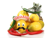 Sombrero and lemon. Fresh lemon stacked in rows and mexican toy Stock Photo