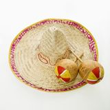 Sombrero and maracas. Royalty Free Stock Images