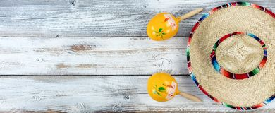 Sombrero with maracas for Cinco de Mayo on weathered white wooden boards royalty free stock image