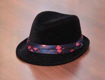 Sombrero negro del niño Imagen de archivo libre de regalías