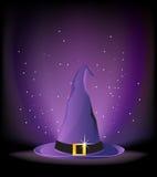 Sombrero púrpura de la bruja Foto de archivo libre de regalías