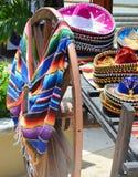 Sombrero and poncho Stock Image