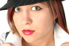 Sombrero que desgasta de la muchacha hermosa Foto de archivo libre de regalías