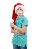 Sombrero rojo agujereado de santa del ingenio del adolescente Fotografía de archivo