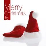 Sombrero rojo de Papá Noel en el fondo blanco. Imágenes de archivo libres de regalías