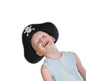 Sombrero sonriente joven del pirata del muchacho que desgasta Foto de archivo