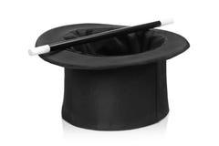 Sombrero superior y una varita mágica Imagenes de archivo