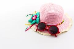 Sombrero tejido rosa y gafas de sol rojas Fotografía de archivo