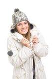 Sombrero y chaqueta de la gorrita tejida del adolescente que llevan lindo Imagen de archivo
