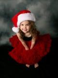 Sombrero y falda de santa de la Navidad de la niña que desgastan Fotografía de archivo libre de regalías
