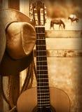 Sombrero y guitarra de vaquero Fondo americano de la música imagen de archivo libre de regalías