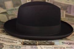 Sombrero y pluma Imagenes de archivo