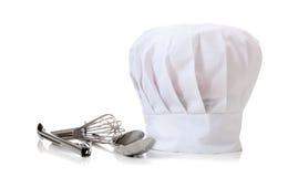 Sombrero y utensilios del cocinero Imágenes de archivo libres de regalías