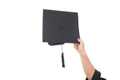 Sombreros de la graduación de la mano que lanzan Fotografía de archivo libre de regalías