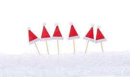 Sombreros de la Navidad, palillos Foto de archivo libre de regalías