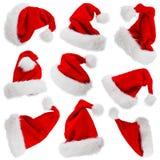 Sombreros de Santa Claus aislados en blanco Imágenes de archivo libres de regalías