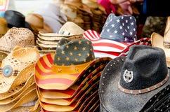 Sombreros de vaquero de la paja en América Foto de archivo