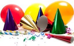 Sombreros del partido en un fondo blanco Fotos de archivo libres de regalías