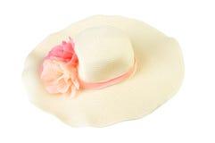 Sombreros grandes con las flores aisladas en el fondo blanco imagen de archivo
