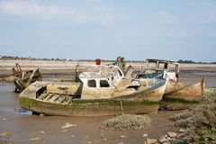 Some wrecks in the cemetery of boats at low tide royalty free stock images