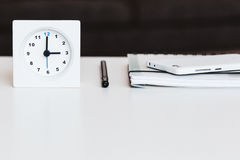Some accessories on a white desk Royalty Free Stock Photos