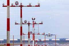 Airport beacons with starting airplane in the daylight. Some airport beacons with starting airplane in the daylight Royalty Free Stock Images