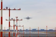 Airport beacons with starting airplane in the daylight. Some airport beacons with starting airplane in the daylight Stock Photo