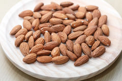 Some almonds in a wooden bowl view from above. General view royalty free stock image