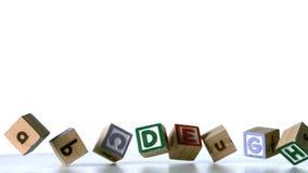 Some alphabet blocks falling over Royalty Free Stock Photos