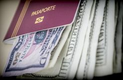 Some American tickets dollars inside a passport Stock Photos