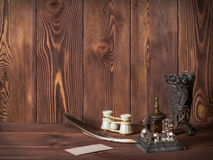 Some antiques on the wooden table. Several ancient things on wooden table. Side view royalty free stock images