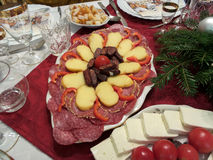 Some apetizer. Cheese mozzarella and tomato, sausage on a dish at the christmas table Stock Image