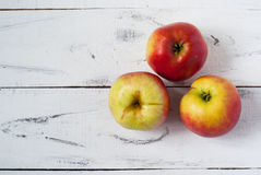 Some apples. Red and yellow apples on white wooden table. Top view royalty free stock photo