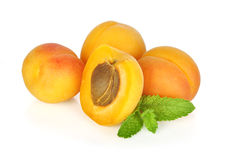 Some apricots. With leaves isolated on white background Stock Photo