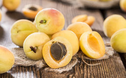 Some Apricots. Some fresh and sweet Apricots on vintage wooden background stock image