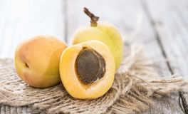 Some Apricots. Some fresh and sweet Apricots on vintage wooden background Royalty Free Stock Photography